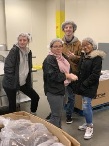 students working at the food bank